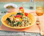 A perfect lunch for a late summers day, this cauliflower and pistachio couscous with halloumi and vegetable kebabs is sure to hit the spot!