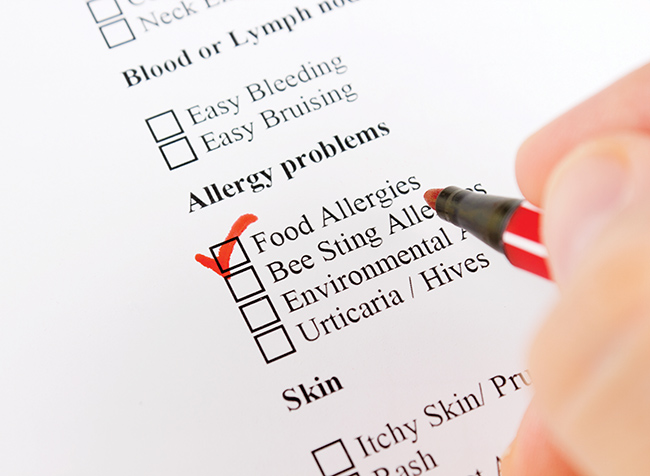 difference between food allergies and intolerances