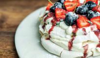 Vegan pavlova, with a boozy cherry sauce