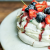 Vegan pavlova, with a boozy cherry sauce